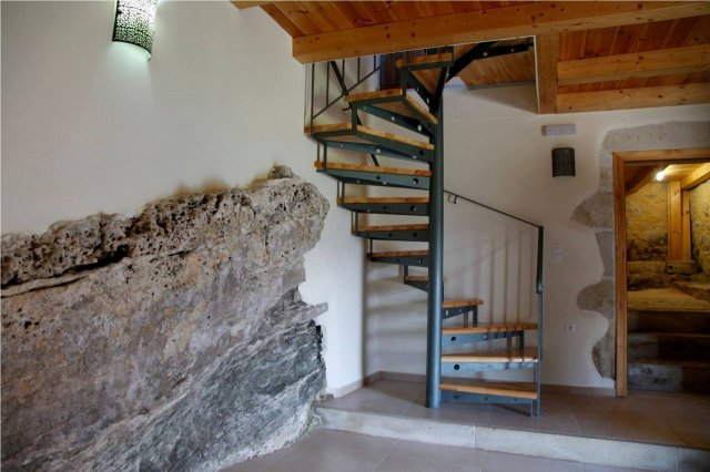 Natural rock integrated in original building